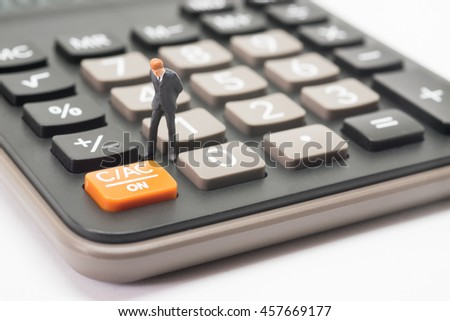 Business startup calculating concept. Businessman thinking or making decision with calculator.