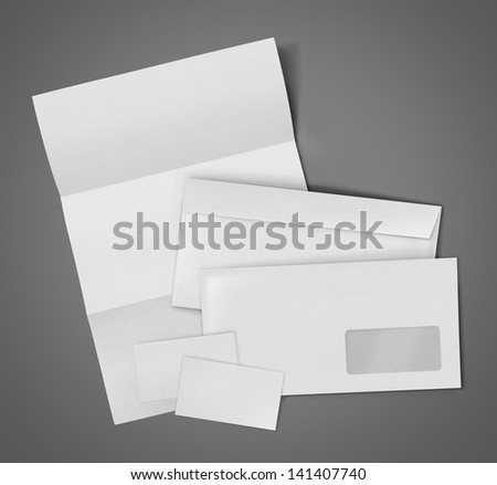 business stationary set. envelope, sheet of paper and business card on gray background - stock photo