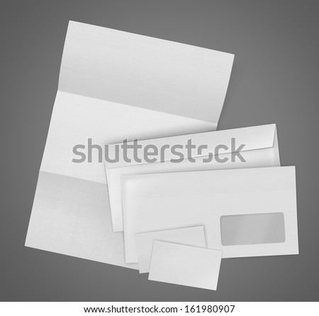 business stationary set. envelope, sheet of paper and business card on gray background