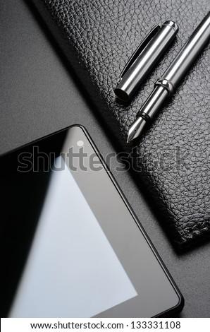 Business still life: card holder, tablet, fountain pen. - stock photo