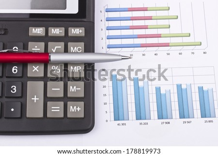 Business still-life charts, pen, calculator
