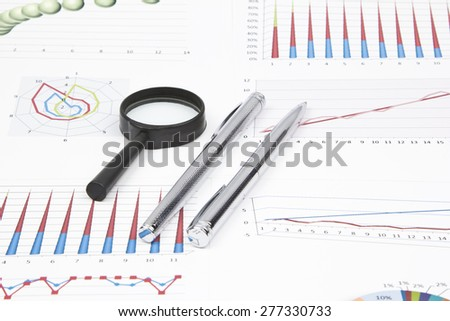 Business still-life diagrams, magnifier, two pen