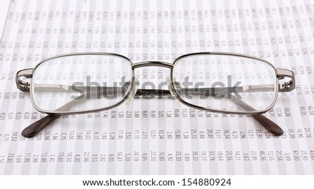 Business still-life from the table, eyeglasses