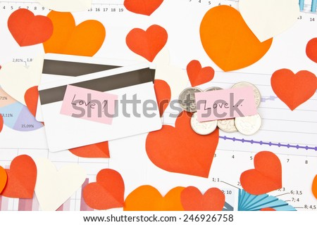 Business still-life of a coins, credit cards, text message, many heart - stock photo