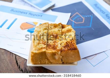 Business still-life of charts, calculator, breakfast,center focus - stock photo
