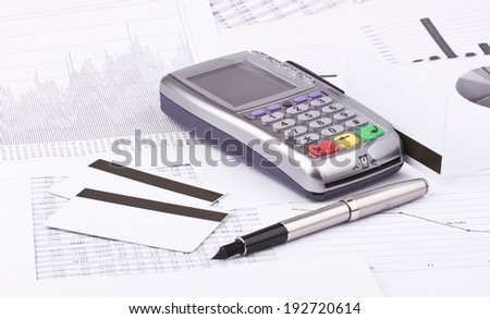 Business still-life of tables, payment terminal, credit Cards, eyeglasses, ink pen - stock photo