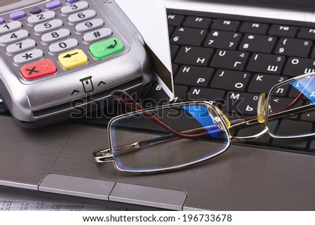 Business still-life of tables, payment terminal, credit Cards, notebook, eyeglasses