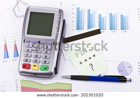 Business still-life of tables, payment terminal, credit Cards, pen, sticker - stock photo