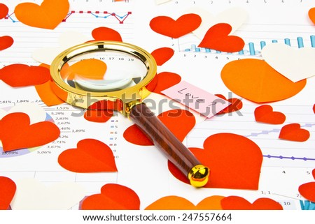 Business still-life of the magnifier, text message, many heart - stock photo