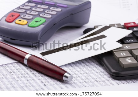 Business still-life: payment terminal, credit cards, calculator, pen - stock photo