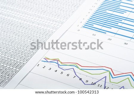 Business still-life with diagrams, charts and numbers. Studio shot