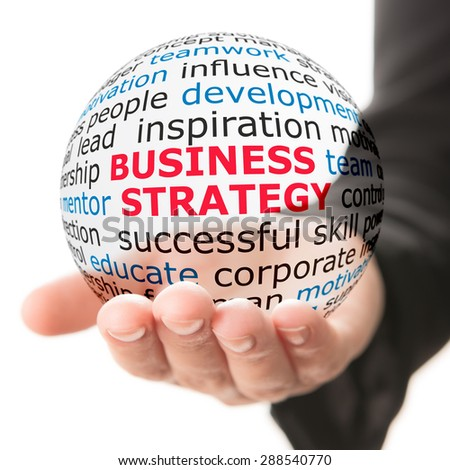 Business strategy concept. Transparent ball with inscription business strategy in the hand - stock photo