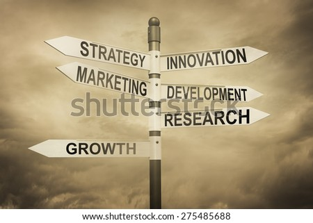 Business,strategy,marketing,development concept with road sign - stock photo