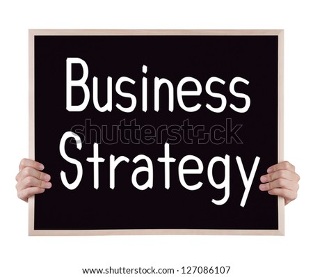 business strategy on blackboard with hands