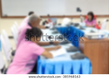Business student, blur blurred abstract education training conference or room seminar meeting People analyze Statistics Financial Concept with computer and projector Movie screen.