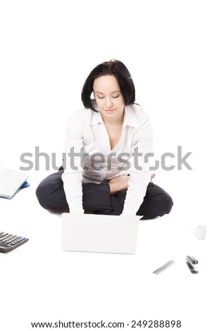 Business, study, healthy lifestyle, work at home. Young female in white shirt surrounded by office items sitting in yoga Padmasana (Lotus Pose) working, typing on laptop on white background, isolated - stock photo