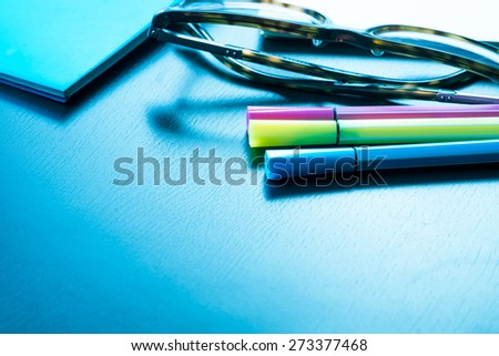 business stuff on work desk.glasses,magic pen,notebook - stock photo