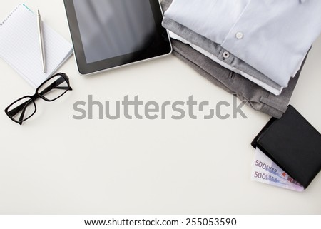 business, style, clothes and objects concept - close up of formal male clothes and personal stuff on table at home - stock photo