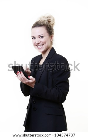 business style image of woman standing working our sums on a calculator