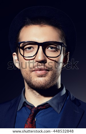 Business style. Portrait of a handsome man wearing elegant suit and spectacles. Men's beauty, fashion.  - stock photo