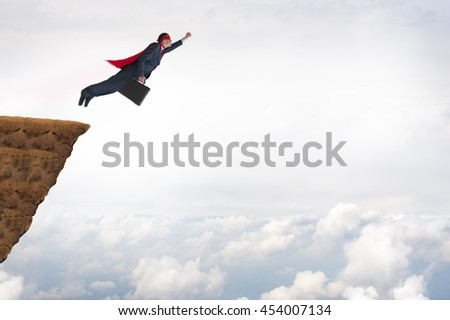 business success concept superhero businessman flying - stock photo