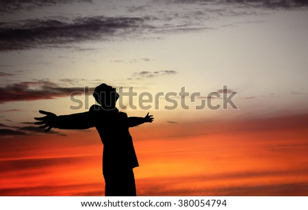 Business success concept with sunset sky and silhouette