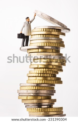 Business success. Figure holding up euro coin - stock photo