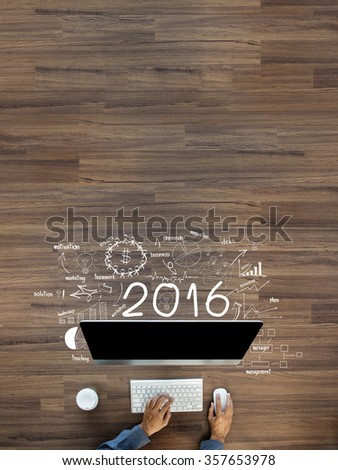 Business success 2016 new year, Creative thinking drawing charts and graphs strategy plan ideas wooden table background, Inspiration concept with businessman working on desktop computer, Top View - stock photo