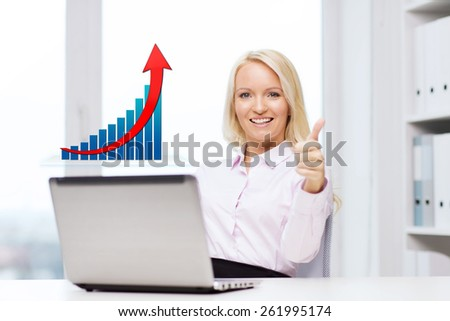 business, success, people, gesture and technology concept - smiling businesswoman showing thumbs up with laptop computer and growing chart in office - stock photo
