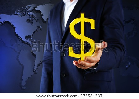 Business success strategy concept.Young man with currency sign in hands on world map background