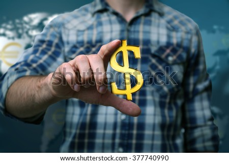 Business success strategy concept.Young man with dollar sign in hands on world map background