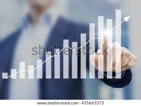 Business success with growing, rising charts and businessman in background