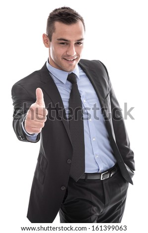 Business: successful man in suit with thumbs up and hand in pocket isolated on white background