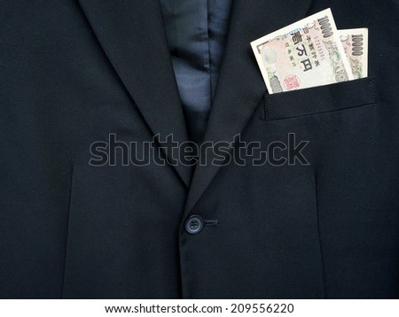 business suit and Japan bills in the pocket