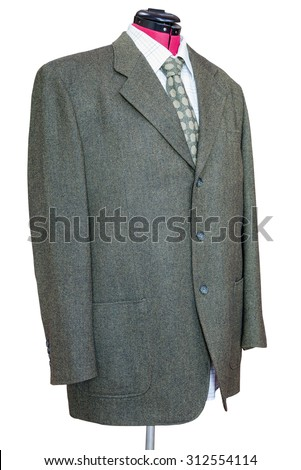 business suit on tailor mannequin - green tweed jacket with shirt and tie isolated on white background - stock photo