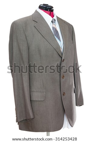 business suit on tailor mannequin - green woolen jacket with shirt and tie isolated on white background - stock photo