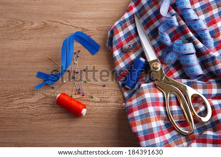 Business suit tailoring, on wooden background - stock photo