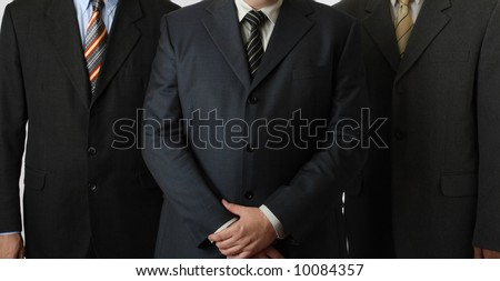 Business suits, ties and hands - stock photo