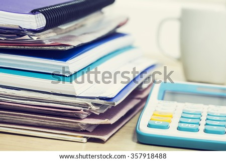 Business table with calculator - stock photo