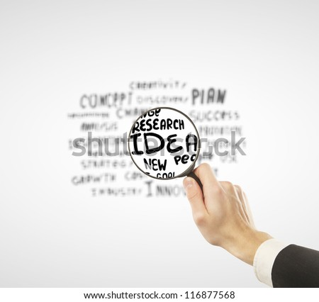 business tags through lens  on a white background - stock photo
