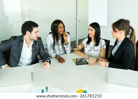 Business talk while sitting at a table and analyzing  results - stock photo