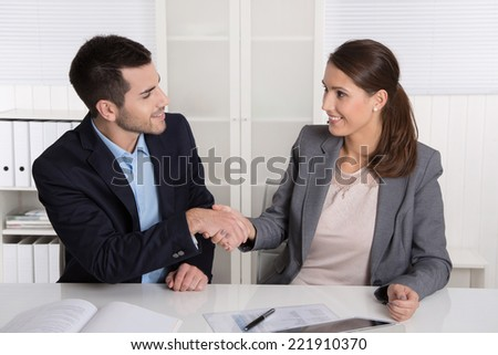 Business talk with shaking hands: counselor and customer or hello to a new colleague. - stock photo