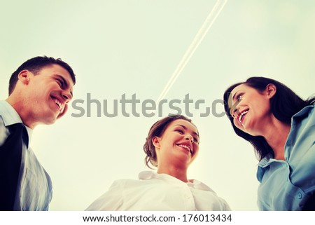 Business team, against blue sky - stock photo