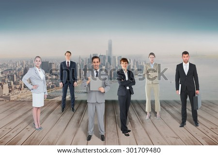 Business team against city projection on wall