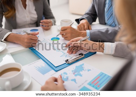 Business team analyzing financial document