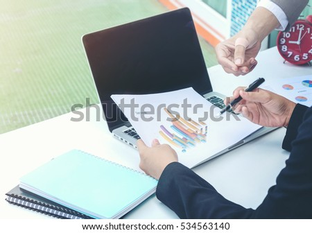 Business team analyzing income charts and graphs with laptop computer,business strategy concept., selective focus