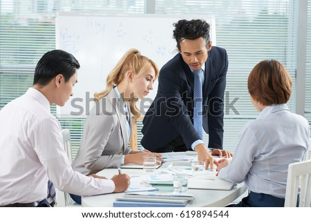 Business team analyzing lates financial report