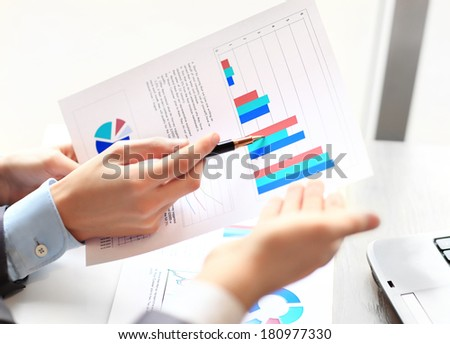 Business team analyzing market research results together - stock photo