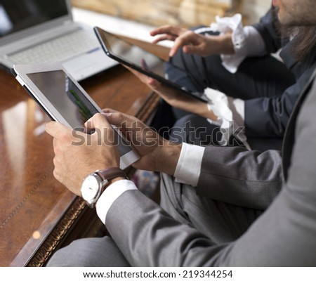 business team and tablet computer in office - stock photo