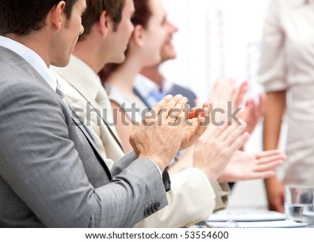 Business team applauding a presentation in the office